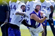 New Vikings cornerback Patrick Peterson, left, covers receiver Adam Thielen during Wednesday's practice.