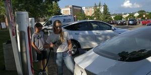 Keli Selness of Wayzata prepared to charge her Tesla before shopping at a Target in St. Louis Park with her husband and two sons last week.