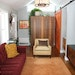 This home office/studio features a bold sofa and a sliding barn door, two trends that could become dated.