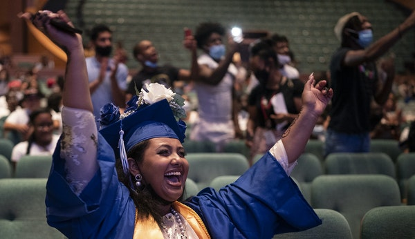 Rahma Yusuf valedictorian for the 2021 North Community High School celebrates as classmates are names are called to receive their diplomas . Jerry Hol