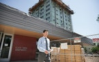 """Mayor Jacob Frey told reporters at the Elliot Twins public housing complex that """"people are struggling to make ends meet."""""""