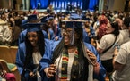 Zacaria Blair and her 2021 North Community High School graduation classmates danced their way out of the building after receiving their high school di
