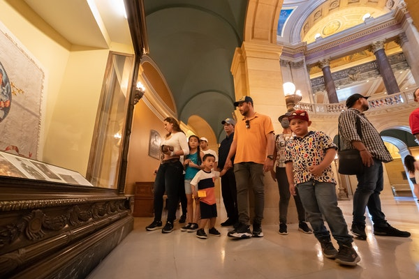 Brany Guevara, left, of St Cloud, brought 11 of her relatives who were visiting from Colombia, to the State Capitol.  They were some of the first memb