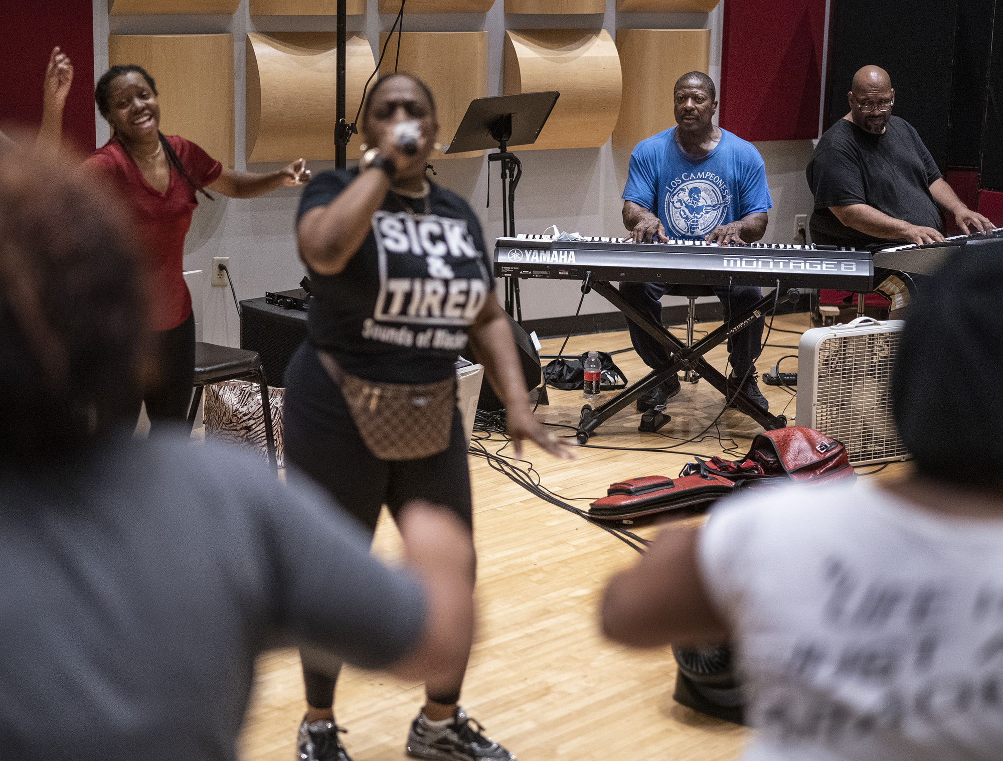 Jamecia Bennett left, Gary Hines and Billy Steele during rehearsal for performance at George Floyd Square.