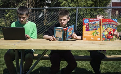 In Owatonna, Minn., the Hadt siblings, from left, Riley, 14, Carter, 11, and Abigail, 7, took advantage of the weather to read outside.