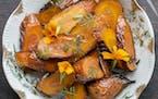 Author Alan Bergo harvests marigolds to complement roasted carrots. Find the recipe at startribune.com/taste.