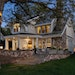 Outdoor spaces at this $4.4 million Lake Minnetonka home include an expansive stone patio.