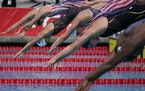 A women's 100-meter freestyle race at a TYR Pro Swim Series swim meet in April.