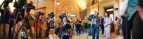 Gov. Tim Walz and Lt. Gov. Peggy Flanagan spoke at a press conference inside the Minnesota State Capitol this week, while a school choice group gather