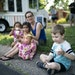Alex Hansen, 6, ate ice cream from a MN Nice Cream food truck parked in Arden Hills while sitting next to Julie Casillas and her daughters Ana and Gia