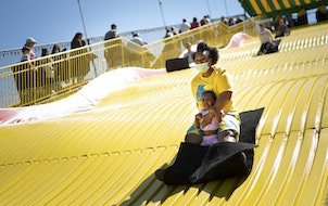 Shawnda Henderson, of Minneapolis, rode the Giant slide with her daughter Mira on the last day of the Kickoff to Summer at the Fair event in May at th