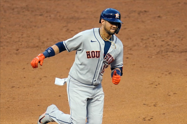 Houston's Yuli Gurriel jogged around the bases on a solo home run off Twins reliever Jorge Alcala in the sixth inning
