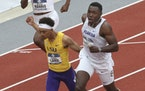 Florida's Joseph Fahnbulleh, right, edges out LSU's Terrance Laire at the finish to win the men's 200 meters