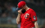 Matt Shoemaker walks to the dugout after giving up two runs to the Astros in the ninth inning