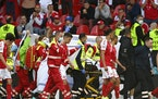 Denmark's Christian Eriksen is taken away on a stretcher after collapsing on the pitch during the Euro 2020 soccer championship group B match betwee