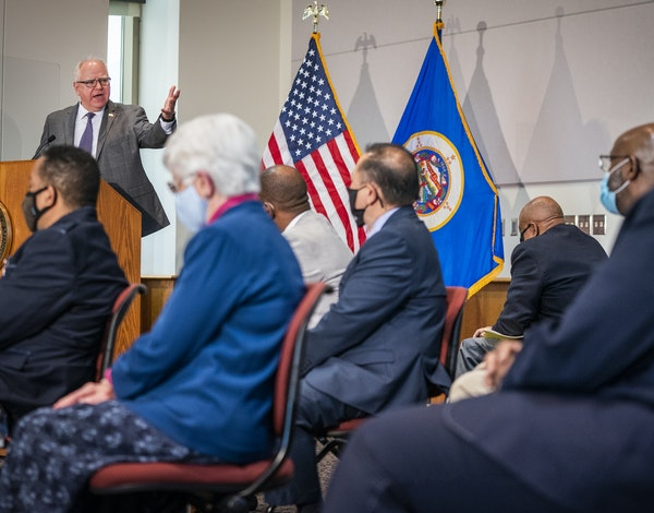 Gov. Tim Walz spoke at a news conference with community leaders and DFL lawmakers regarding police reform proposals.