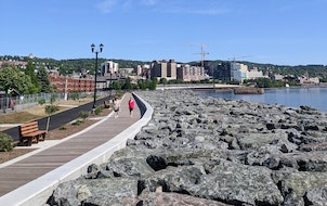 Visitors strolled the reconstructed Lakewalk in Duluth. The popular path reopened Friday after more than a year of work to make it better prepared for