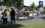 Visitors pay tribute to the display outside the Pulse nightclub memorial Friday, June 11, 2021, in Orlando, Fla.