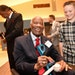 """Jim """"Mudcat"""" Grant signed an autograph for Quinn Brooks of Sioux Falls, S.D., during the 2017 Diamond Awards at Target Field."""