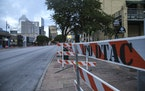Road block barriers sit on the sidewalk on 6th Street after an early morning shooting on Saturday, June 12, 2021 in downtown Austin, Texas.