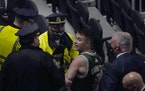 A fan was handcuffed and escorted out of TD Garden by police after allegedly throwing a water bottle at Brooklyn's Kyrie Irving as Irving left the c