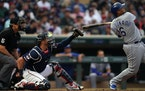 """Twins catcher Mitch Garver, right, uses a """"one-knee-down"""" setup to improve his form with pitches low in the strike zone."""