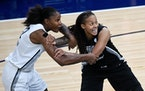 Longtime teammates Rebekkah Brunson, left, and Seimone Augustus were on opposite sides for the WNBA All-Star Game in 2018. Their jerseys will now hang