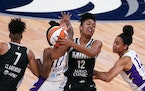 Los Angeles Sparks guard Erica Wheeler (17) collided with Minnesota Lynx forward Damiris Dantas (12) in the first quarter.