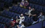 A fan danced in the stands during a game March 24. Is there a period of such celebration building for the Wolves?