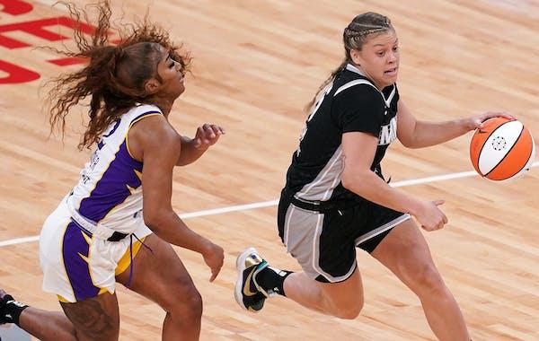 Lynx guard Rachel Banham (15) drove past Los Angeles Sparks guard Te'a Cooper (2) in a game earlier this season.