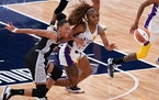 Aerial Powers of the Lynx and Los Angeles Sparks guard Te'a Cooper (2) raced for a loose ball Saturday.