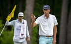 Chesson Hadley waves to the crowd after making a birdie putt on the 12th hole during the third round of the Palmetto Championship