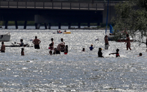 Swimmers flocked to Lake Nokomis has the heat soared in the Twin Cities last July. Water-related incidents claimed three lives and left one seriously