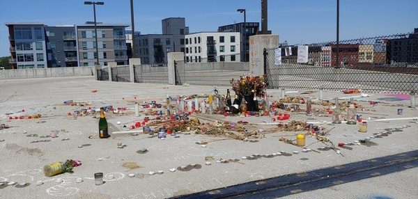 A memorial has sprung up on the fifth floor of the parking garage at Seven Points (formerly Calhoun Square), where Winston Smith was killed June 3 by