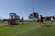 Former Gophers soccer player Maddie Castro shot to sink Andrea Yoch into the dunk tank at Elizabeth Lyle Robbie Stadium. On Sunday, Yoch was announced