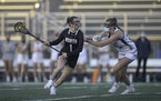 Prior Lake all-state player Payton Bloedow, right, pressured Lakeville North's Alex Ward in an April game. Bloedow and the Lakers won the 2019 state