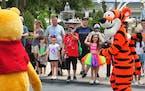 Young guests enjoy seeing Winnie The Pooh, and Tigger too, at the Magic Kingdom at Walt Disney World, in Lake Buena Vista, Fla., Monday, May 17, 2021,