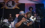Vocalist Julius Collins embraced Lisa Franze, widow of co-founder Billy Franze, during Dr. Mambo Combo's first set at Hook & Ladder Sunday night. Th