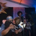 Vocalist Julius Collins embraced Lisa Franze, widow of co-founder Billy Franze, during Dr. Mambo Combo's first set at Hook & Ladder Sunday night.