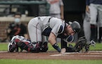 Mitch Garver reacts after a foul ball hit him in the groin on June 1 in Baltimore. He hasn't played since.