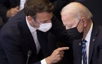 U.S. President Joe Biden, right, speaks with French President Emmanuel Macron during a plenary session during a NATO summit at NATO headquarters in Br
