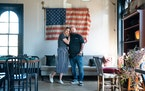 Hope Breakfast Bar owners Brian and Sarah Ingram, on a busy Tuesday morning. This flag, on display in the upstairs dining area, was found in the wall