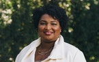 Above, Stacey Abrams at home in Atlanta.