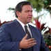 Florida Gov. Ron DeSantis, seen on April 2, 2021, signed a bill into law that would require public schools in his state to set aside at least one minu