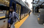 Commuters disembarked from a light rail train at the Nicollet Mall station during the morning rush hour on June 23, 2020, in Minneapolis. Metro Transi