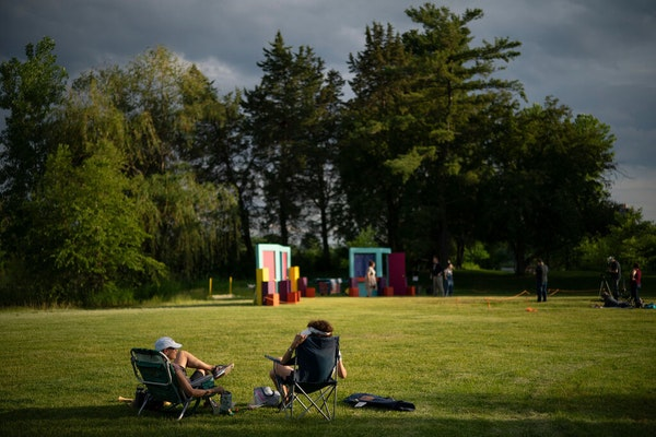 Spectators watched an outdoor performance at Lake of the Isles in Minneapolis in 2019. After a years-long struggle the Minneapolis Park Board has agre