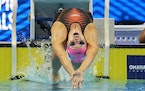 Lakeville's Regan Smith's time of 57.92 seconds in the 100 backstroke semifinals at the U.S. Olympic swimming trials Monday set a U.S. open record