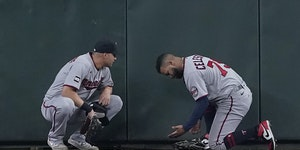 Twins center fielder Gilberto Celestino, right, talked with right fielder Alex Kirilloff after Celestino, who hit a homer in the previous inning, was
