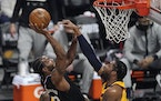 Clippers forward Kawhi Leonard shot as Jazz center Derrick Favors defended during the first half in Game 4 of a second-round NBA playoff series Monday