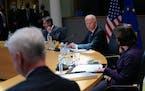 President Joe Biden attends the United States-European Union Summit with Secretary of State Antony Blinken, back left, and Commerce Secretary Gina Rai